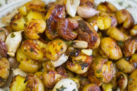 Crushed and roasted new potatoes with garlic and parsley