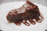 Chocolate, ginger and pear torte with hot chocolate sauce